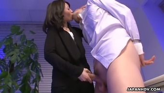 Confident Asian Nympho Mitsuki Gives Her Horny Co-Worker A Nice Footjob