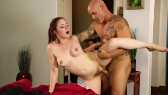 Redhead Fucked On The Massage Table By A Muscular Guy