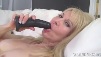 Erica Lauren Knows How To Use A Black Dildo On Her Warm Pussy