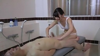 Sexy Japanese Chick Pleases A Guy By Massaging His Hard Pecker