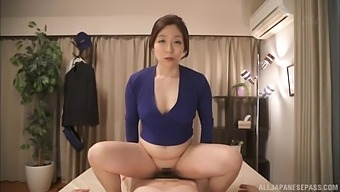 Asian Mom Rides Cock In Reverse During Massage Session