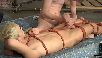 Nothing Pleases This Tied Up Guy As Getting His Cock Jerked Off