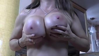 Big Tit Babe Strokes, Sucks, Slaps, Pinches And Twists Her Oiled Tits.