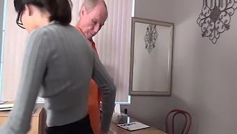 Bitch Warden Jerks Off A Prisoner!!