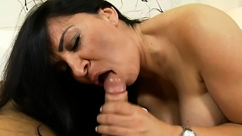 Hot Brunette Milf With Big Boobs Gives A Blowjob